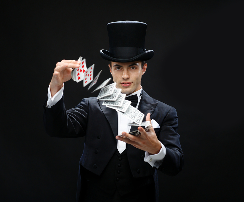 magician-showing-trick-with-playing-cards.jpg