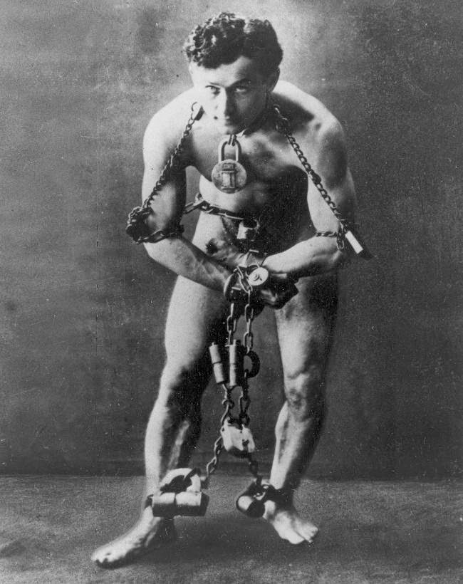Harry Houdini posing in shackles