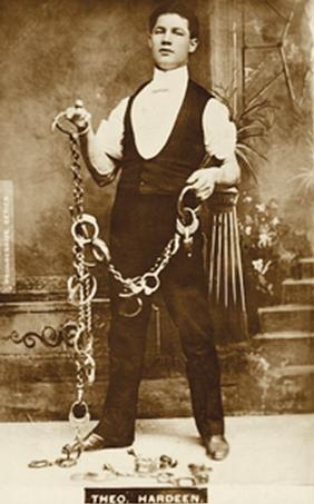Theodore Hardeen posing with open handcuffs